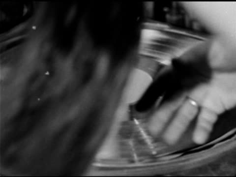vidéos et rushes de male technician placing master shell on turntable wiping disc placing protective layers on center of disc pushing into record making machine lifting... - disque vinyle