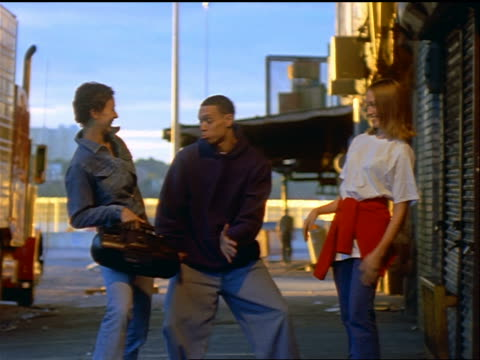vidéos et rushes de 3 male teens dancing + showing off for 2 laughing girls with stereo / nyc - 1990 1999