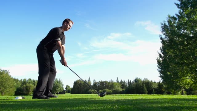 male tees off - golf swing stock videos & royalty-free footage