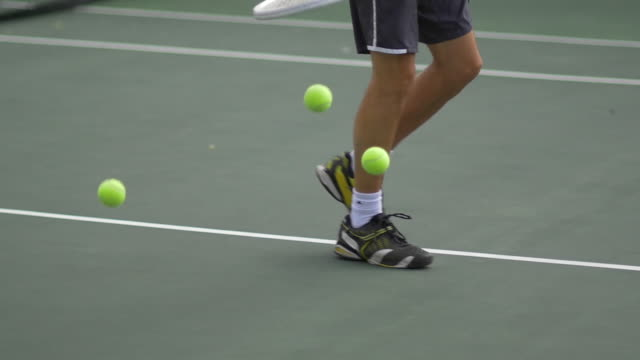 male tennis player bouncing tennis ball with racket.  - slow motion - tennis racket stock videos & royalty-free footage
