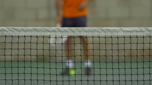 male tennis player bouncing tennis ball with racket.  - slow motion - tennis stock videos & royalty-free footage