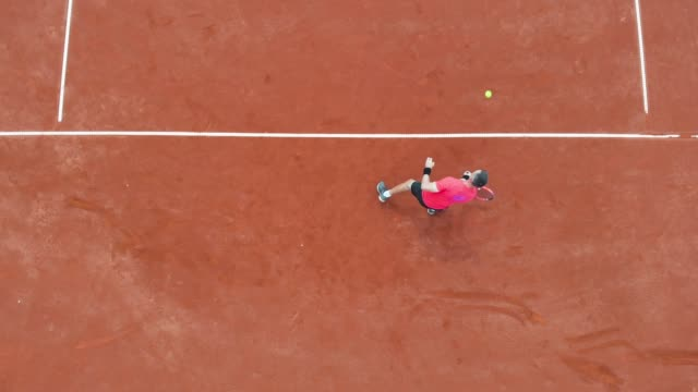 male tennis player playing tennis - taking a shot sport stock videos & royalty-free footage