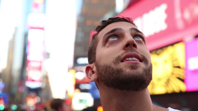 male tourist observing the lights of the times square - international landmark stock videos & royalty-free footage