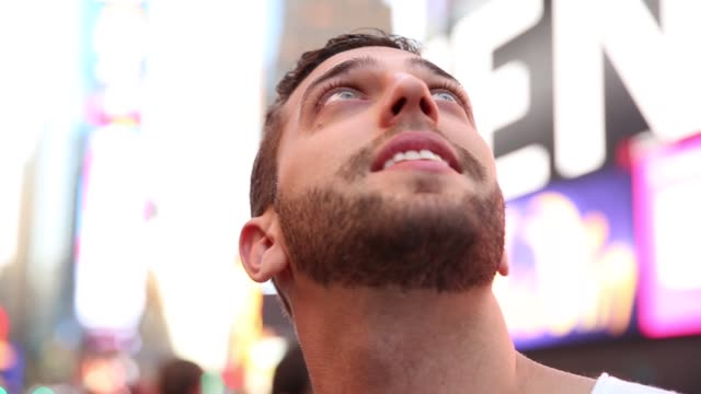 male tourist observing the lights of the times square - times square manhattan stock videos & royalty-free footage