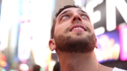 Male tourist observing the lights of the Times Square