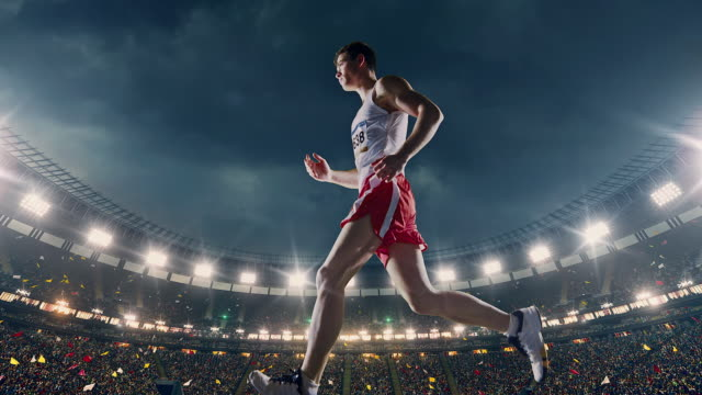 male track and field runner - pista di atletica leggera video stock e b–roll