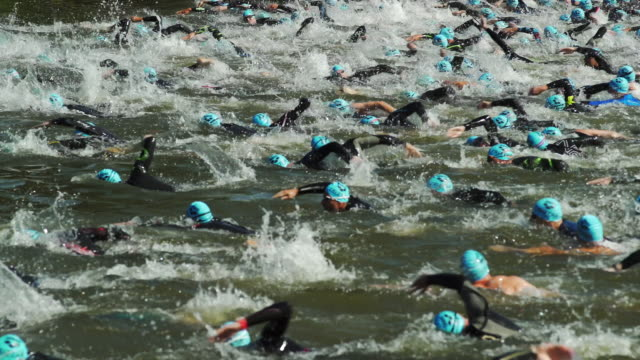 male triathlete swimmers at race in a canal - triathlete stock videos and b-roll footage