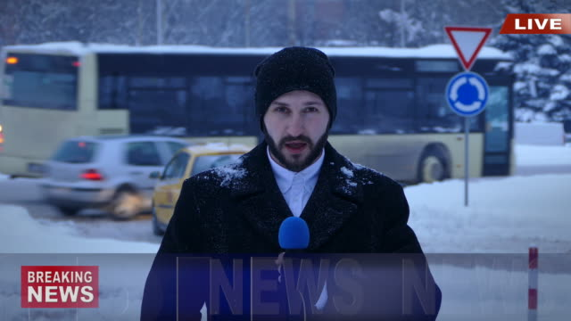 Male TV reporter presenting actual snow situation in town