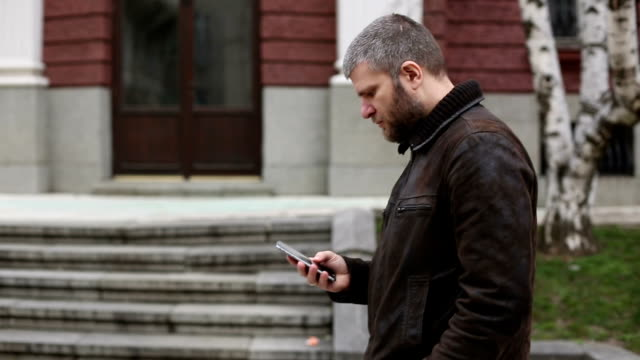 Male using cell phone in the city