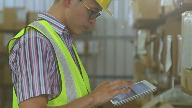 Male using digital tablet in warehouse