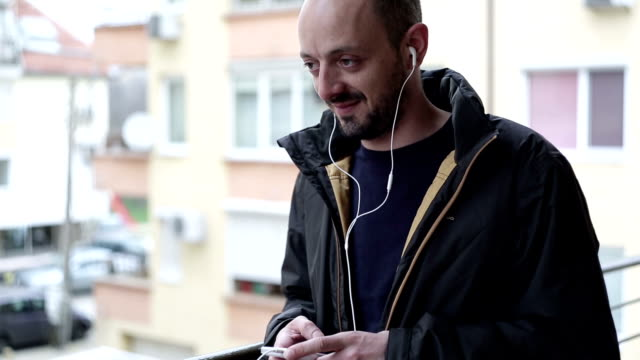 male using phone outside - t shirt stock videos & royalty-free footage