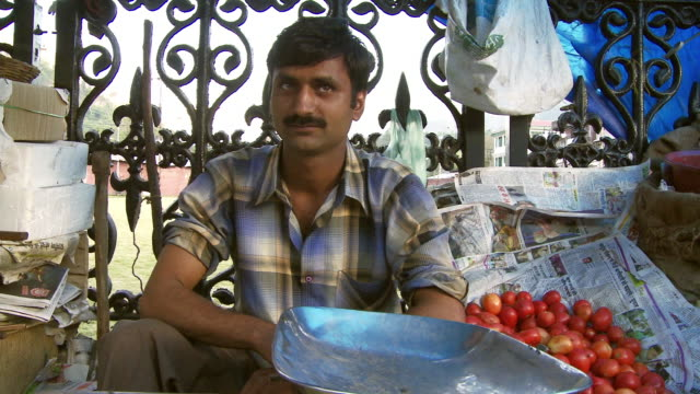 male vendor close up in market in india - retail occupation stock videos and b-roll footage