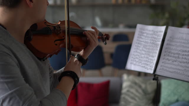male violinist rehearsing music piece at home - violinist stock videos & royalty-free footage