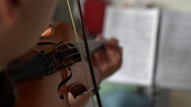 male violinist rehearsing music piece at home - sketch comedy stock videos & royalty-free footage