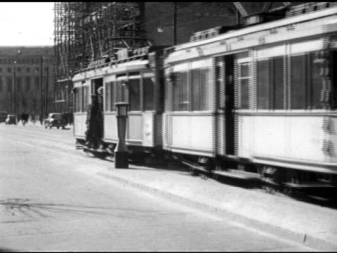 male volkspolizei walking on street vs road trolley pulling up to a stop in west berlin passengers getting off vs male coupling cars together closing... - west berlin stock videos & royalty-free footage