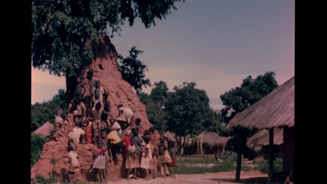 VS African children running to posing w/ termite mound in village children eating insects in field woman 'harvesting' insects from stalks VS Bowl of...