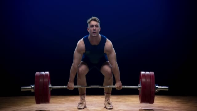 male weightlifter failing to perform the clean and jerk lift at a competition - picking up stock videos & royalty-free footage