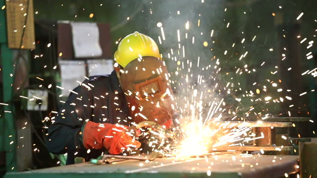 male welder working at factory - engineer stock videos & royalty-free footage