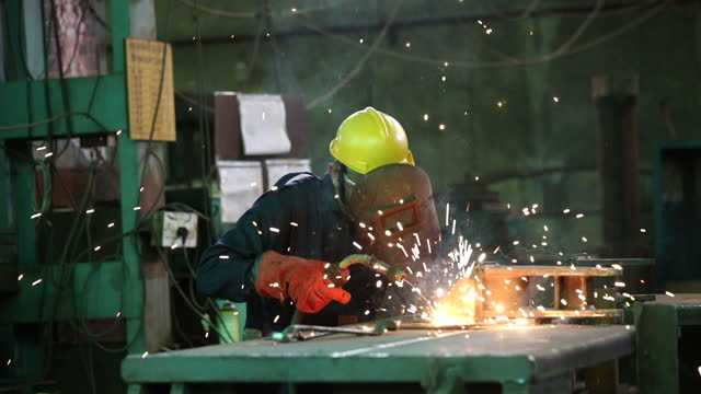 male welder working at factory - welding stock videos & royalty-free footage