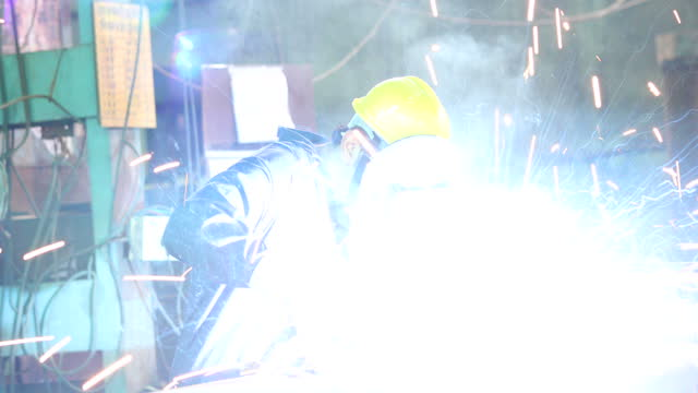 male welder working at factory - manufacturing occupation stock videos & royalty-free footage