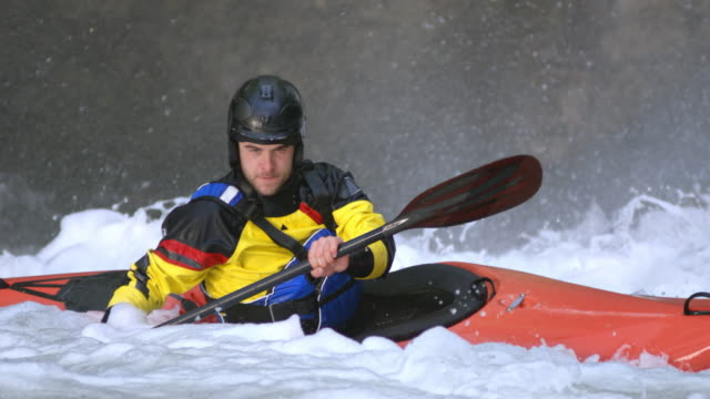 slo mo male whitewater kayaker rolling his kayak - oar stock videos & royalty-free footage