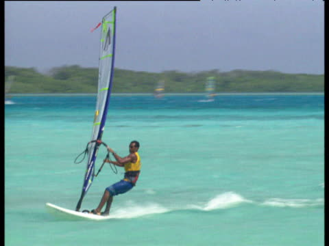 stockvideo's en b-roll-footage met male windsurfers perform jumps tricks and stunts including chacho while competing in the professional windsurfers association world tour 2003 bonaire... - sportkampioenschap