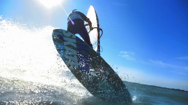 Male windsurfing jump with waterdrops,timeramp