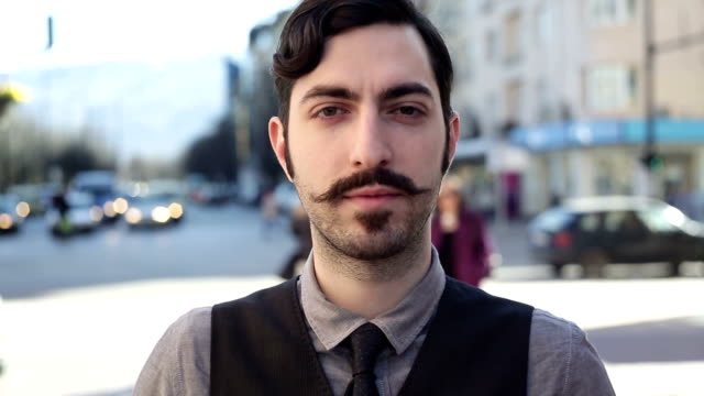 male with moustache posing and looking at camera - moustache stock videos & royalty-free footage