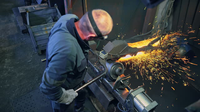 cs male worker linishing a metal casting in a foundry - crane shot stock videos & royalty-free footage