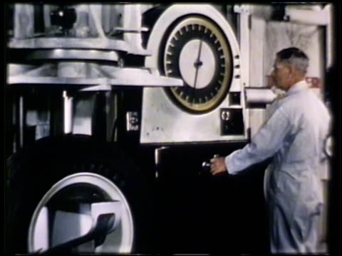 male worker operating test machine testing tire durability under weight pressure ms male operating machine reading large gauge mcu machine pushing... - durability stock videos and b-roll footage
