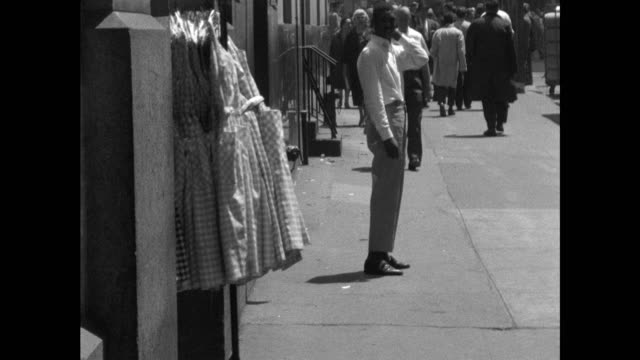 male workers in new york moving rails of clothing - gingham stock videos & royalty-free footage