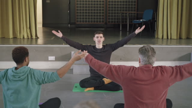 male yoga teacher, teaching yoga to male students - exercise equipment stock videos & royalty-free footage