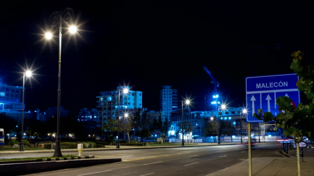 Malecon Road Sign with Traffic and Construction Site on Background Timelapse, Havana, Cuba