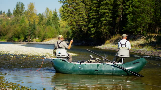 Males fly fishing St Mary River Canada BC