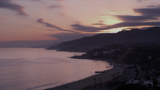 Malibu mountains and coastline, sunset, pink skies and wisps of blue clouds