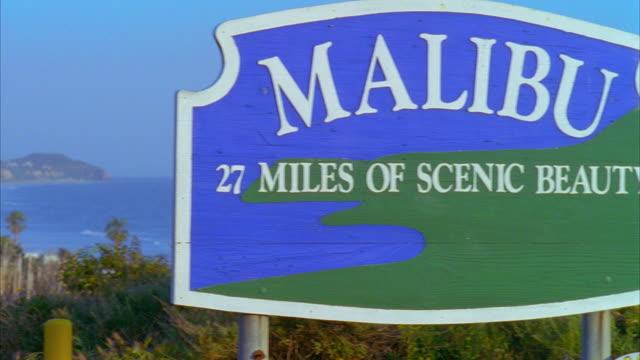 MS PAN 'Malibu' sign at Pacific Coast Highway and ocean, Malibu, California, USA