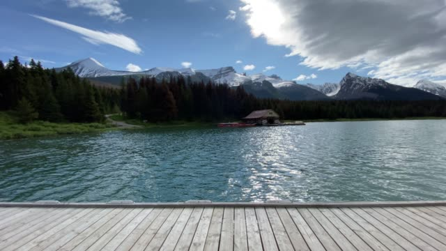 maligne lake at sunrise, alberta, canada - pier stock videos & royalty-free footage