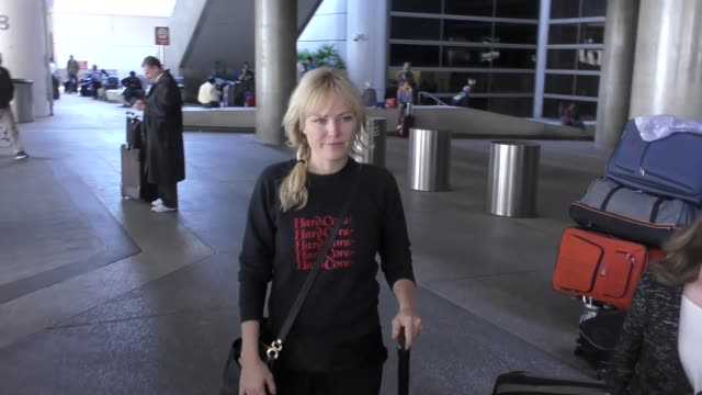 Malin Akerman signs autographs for fans as she arrives at Los Angeles International Airport at Celebrity Sightings in Los Angeles on April 14 2018 in...