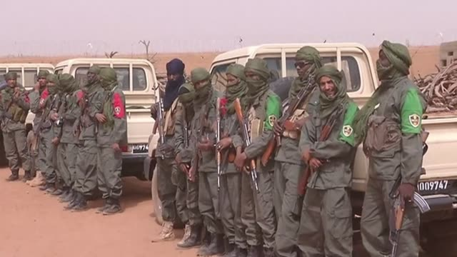 mali's progovernment forces and former rebels take part in their first mixed patrols as the country looks towards establishing a unitary army - rebellion stock videos & royalty-free footage