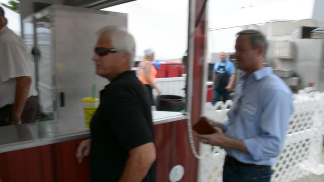 o'malley orders two pork chop on a stick and refuses them free saying he'd be indicted if he didn't pay great conversation with vendor says it's the... - iowa stock videos & royalty-free footage