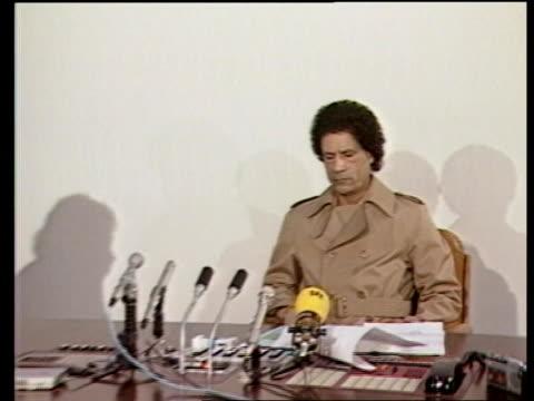malta hijack inj2125b 221284 itn tripoli tms colonel moammer khadafi seated at pkf - muammar gaddafi stock videos & royalty-free footage