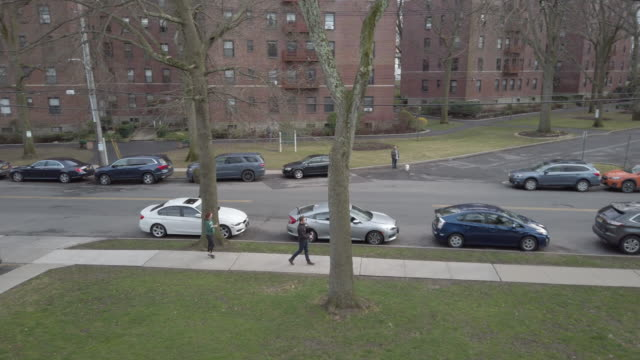 a mamaroneck man celebrates his birthday and st patrick's day by playing bagpipes for westchester residents selfquarantined in their apartments march... - social distancing stock videos & royalty-free footage