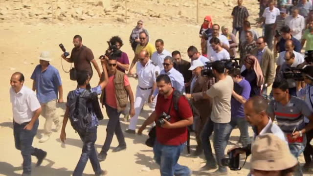 vídeos de stock e filmes b-roll de mamdouh eldamaty egypt's minister of antiquities welcomed small groups of journalists inside the saqqara pyramid a vast ancient burial ground to show... - pyramid
