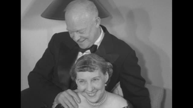 vs mamie eisenhower in evening dress and pearls sits in chair president elect eisenhower sits on back of chair in tuxedo with his hand on her... - 1952 stock videos and b-roll footage