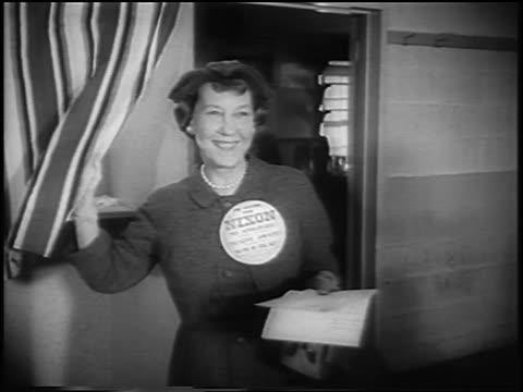 vídeos de stock e filmes b-roll de mamie eisenhower wearing big nixon pin entering voting booth / presidential election - primeira dama