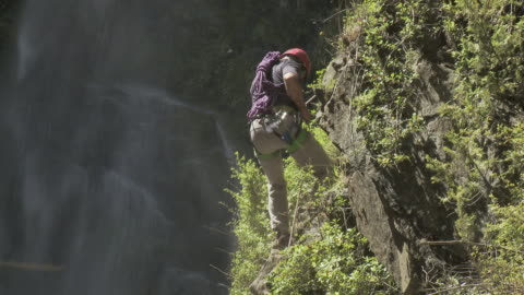 man abseiling by waterfall - argentinian ethnicity stock videos & royalty-free footage
