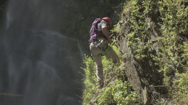 man abseiling by waterfall - abseiling stock videos & royalty-free footage