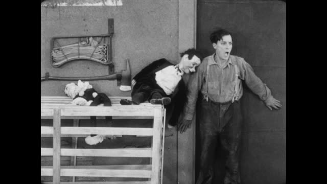 1928 a man (buster keaton) accidentally performs magic trick - puppet stock videos & royalty-free footage