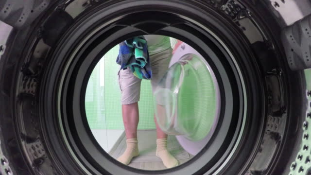 pov of man adding clothes to washing machine - utility room stock videos and b-roll footage