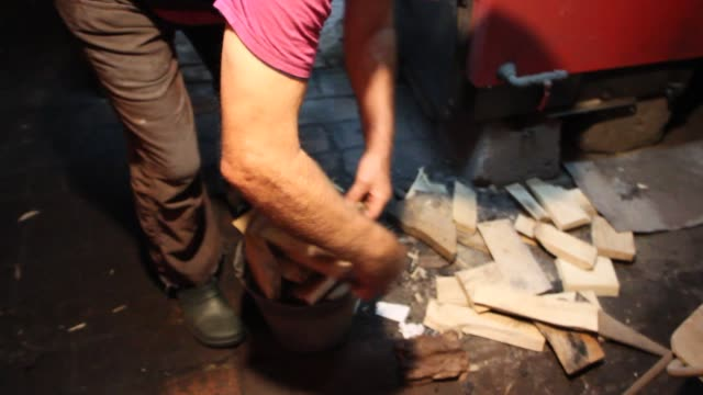 a man adding wet waste anthracite culm coal to a coalfired central heating furnace in a singlefamily house in the countryside is seen in sypniewo... - anthracite coal stock videos & royalty-free footage